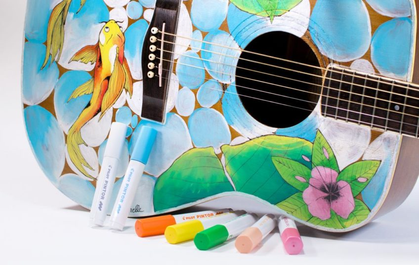 guitar decorated in pintor marker ko fish design pintor markers bright colours