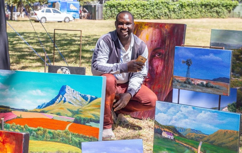 Eric with paintings at Art in the Park Cape Town
