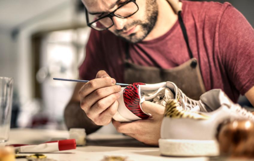 artist painting sneaker